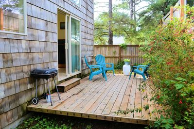 Outside deck with BBQ and 2 chairs - Now fully fenced