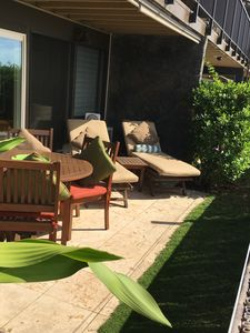 Cozy and semi private lanai with low bamboo accent garden fence.11 ft from water