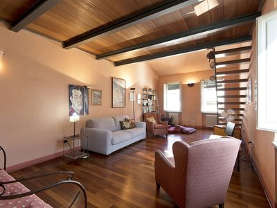 Photo for Romantic attic in Lucca with AC & Wifi