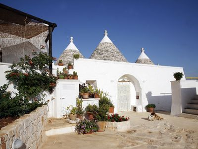 Photo for Trullo + Lamia, 10 minutes from the sea, panoramic views and whirlpool