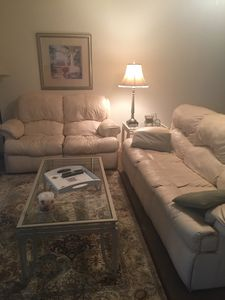 This is the living room with leather sleep sofa and love seat.
