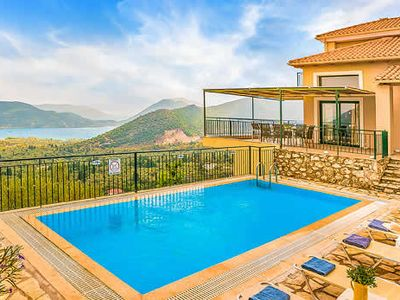 Photo for Fantastic sea views of  nearby islands, close to village taverna. Modern décor, smart with good facilities, peaceful and spacious. Nidri village and beaches a fifteen minute drive.
