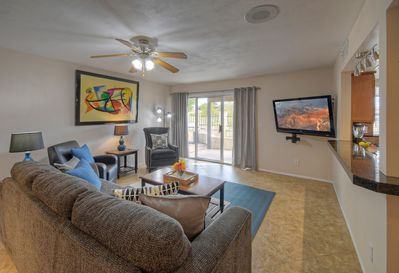 Comfortable seating in great room is arranged to view large TV, plan daily excursions or enjoy the outdoor sights