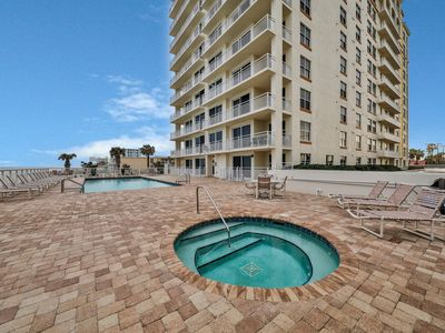 Photo for NEW LISTING! Exquisite condo with shared pool/hot tub - steps from the beach!