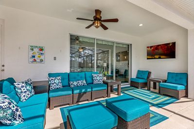 watch TV in our outside sitting room on our sunny pool deck