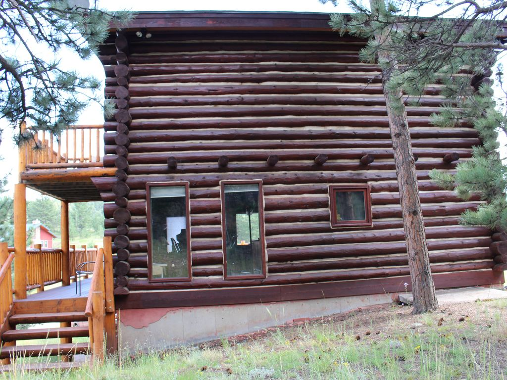 Red log cabin mountain retreat florissant south central for Log cabin retreat