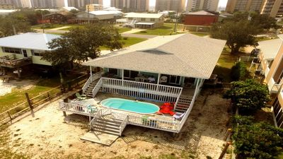 Photo for Lagoon Front One Block to Beach, Pets, Pool, Waterfront, Fenced Yard. 5 Bedrooms