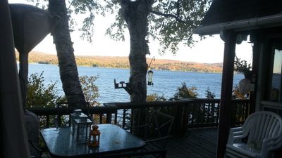 View of lake from top deck with colored trees on other side of lake (taken last fall)