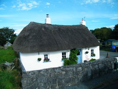 Photo for Beautiful 200 year old Irish Thatched listed cottage restored to original.