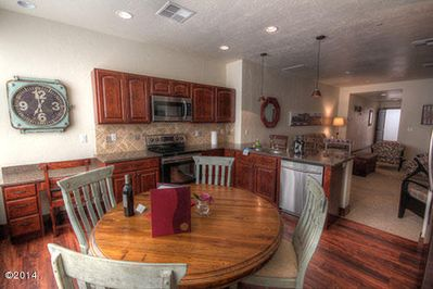KITCHEN OVERLOOKING CENTRAL AVE. W/  ACCESS TO LARGE OUTDOOR DECK W/ FIREPLACE