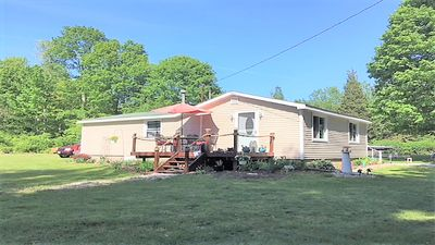 Cottage view with deck & large yard