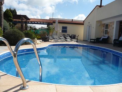 Relax by the Kidney shaped pool. Properly maintained for your safety.