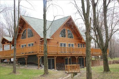 Huge wrap around 15'x75' deck overlooking bridge and 1 acre wooded lot