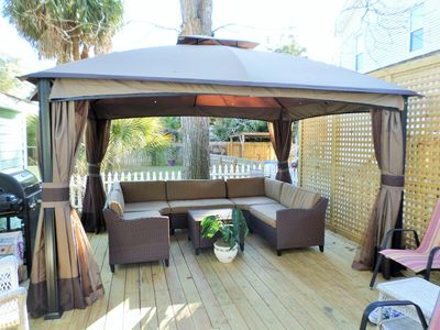 Back deck canopy with sectional couch