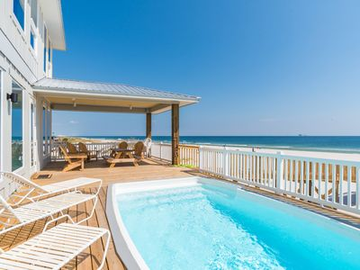 Photo for Beach front w/private heated pool and elevator! Quick online booking for activities!!