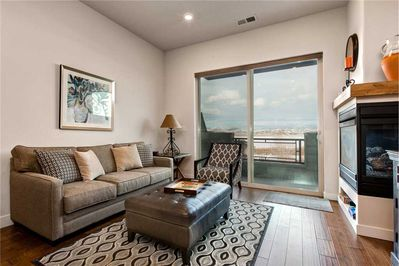 Living Room with Sleeper Sofa, 2-sided Gas Fireplace and Balcony with Views!