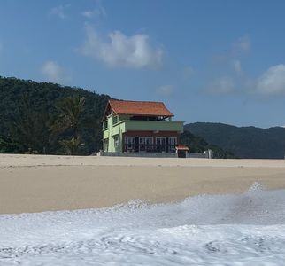Photo for Spectacular ocean front property on a quiet beach one hour from Rio with pool