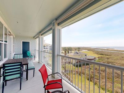 Photo for NEW LISTING! Bay view condo with shared pools/hot tubs/beach club/game room!