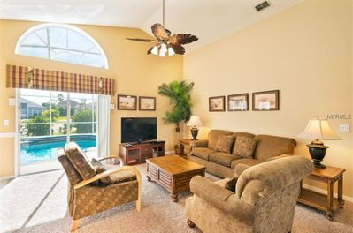 Roomy and bright Family Room features 46' TV, and luxurious furniture