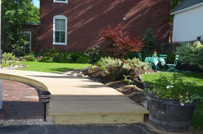 Plenty of garden space in the yard to enjoy a cup of coffee or evening meal.