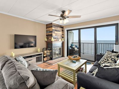 Photo for Stylish 3 bedroom oceanfront condo with free WiFi, front and rear balconies w/ ocean views, and fabulous coastal decor located uptown and just steps to the beach!