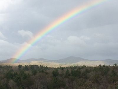 A portion of the panoramic view with a rainbow from the front wrap around porch!