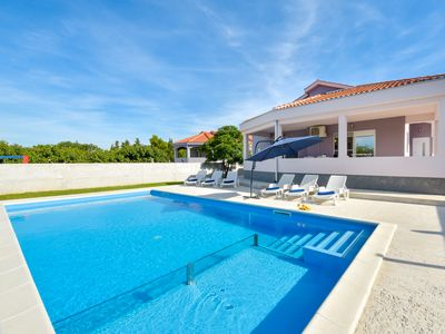 Photo for This 3-bedroom villa for up to 8 guests is located in Novigrad and has a private swimming pool, air-