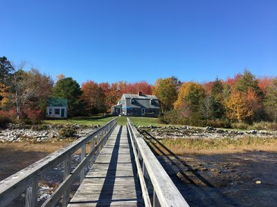 Photo of Harbor House from private dock with fall foliage