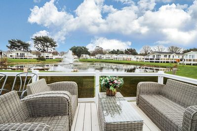Sit on the decking and enjoy great views of the beautiful lake filled with wildlife!