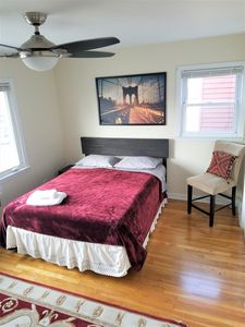 Large master bedroom with a queen size bed and large wardrobe