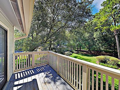 Balcony - A private balcony provides greenery views of the wooded backyard.