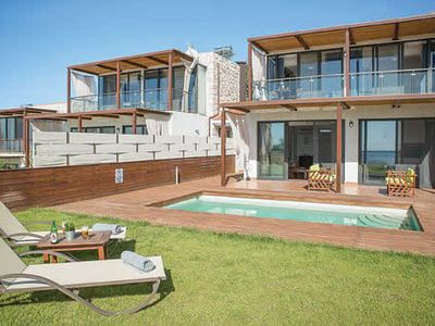 Photo for Newly built 3 bed villas situated close to all amenities inclusive of free Wi-Fi, pool towels, A/C & portable BBQ.