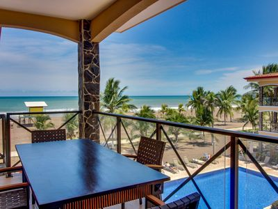Photo for NEW LISTING! Modern oceanfront condo w/beach access, shared pool, great location