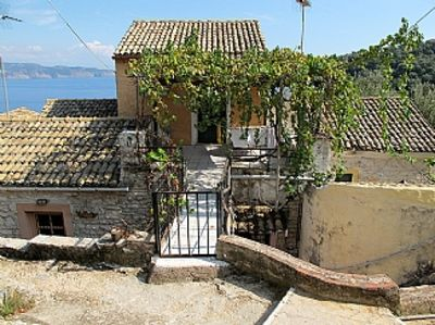 Photo for Nausica House: Cosy renovated cottage, stunning views of Agni Bay