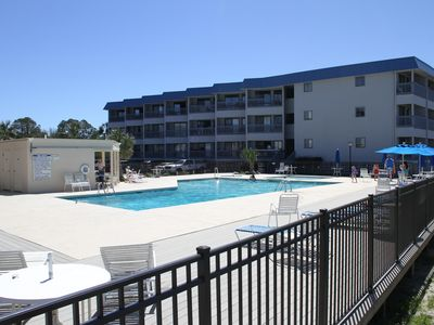 Photo for New listing! Bright, beachy condo. Views of the Savannah River bay and pool!
