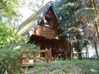 Photo for cozy wooden house in an idyllic pine forest settlement with near fishing waters!