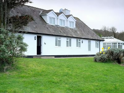 Photo for Incredible dog friendly beach house with hot tub and a beach on its doorstep