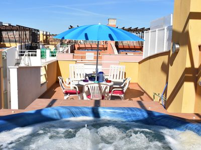Photo for Penthouse  with private jacuzzi, underground parking, 200 meters to beach