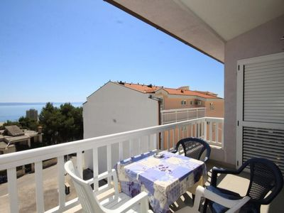 Photo for Two bedroom apartment with terrace and sea view Makarska (A-6640-d)