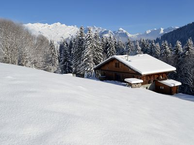 Photo for An idyllic traditional chalet, surrounded by trees and mountains at Samoens 1600