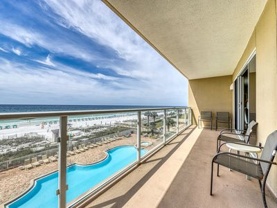 Photo for Spacious beachfront home w/ a shared pool, gym, & outdoor dining area
