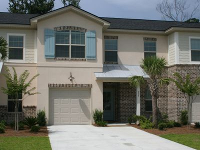 Photo for Perfectly Located Townhouse With Garage and Pool