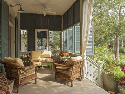 Plush outdoor seating under the ceiling fan for year round comfort.