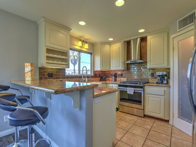 Photo for 3 Story Spanish Style 4bd 3bth Home with private zen garden.