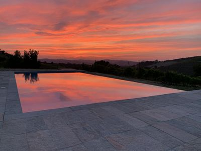 Photo for Villa with vineyards, infinity pool, views of  an UNESCO castle and the alps.