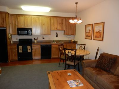 Living room, dining table, and kitchen