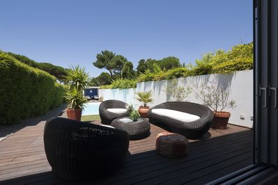 Outdoor seating area overlooking private pool