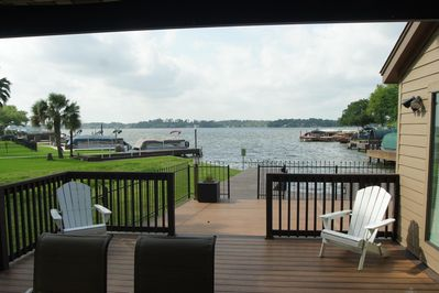 Covered patio and oversized deck with open waterview of Lake Conroe.