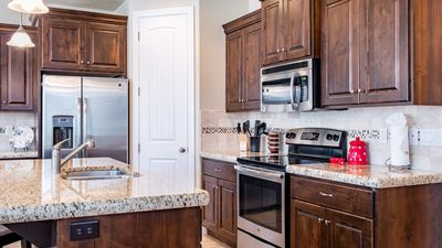 Fully stocked gourmet kitchen featuring all the comforts of home