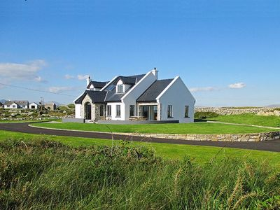 Photo for Exceptional stone faced cottage, recently completed in traditional style, and enjoying sea vie…